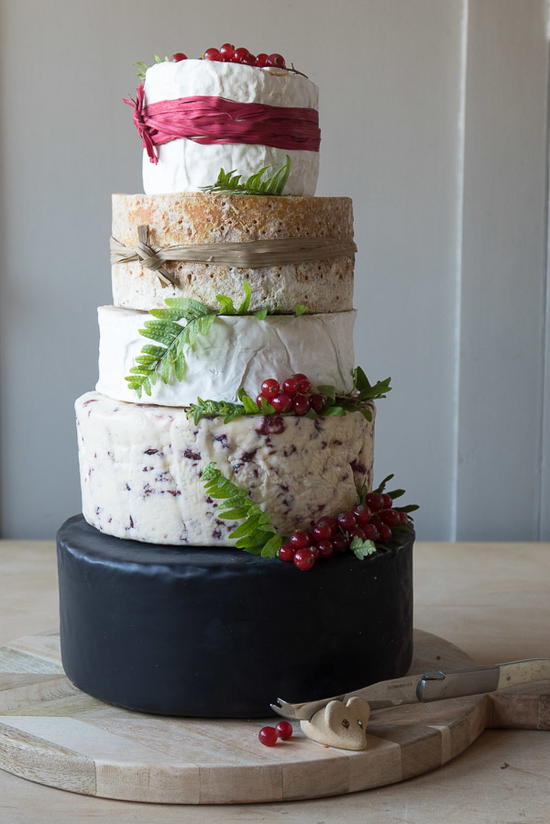 The gorgeous Berry cheese cake featuring 5 tiers of various cheeses including, black bomber,Wensleydale & crandberries, Elmhirst, Stilton and Somerset camembert. Decorated with red berries and red raffia.
