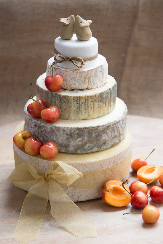 Our Cherry Cheese Cake has 5 tiers including, Devon Oke, Gorwydd Caerphilly, Cashel Blue, Camembert and Vulscombe. Decorated with Cherries and beige ribbons.