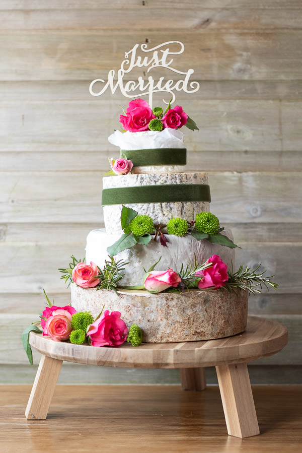 4 tier Angel cheese cake with beautiful green and pink flowers.